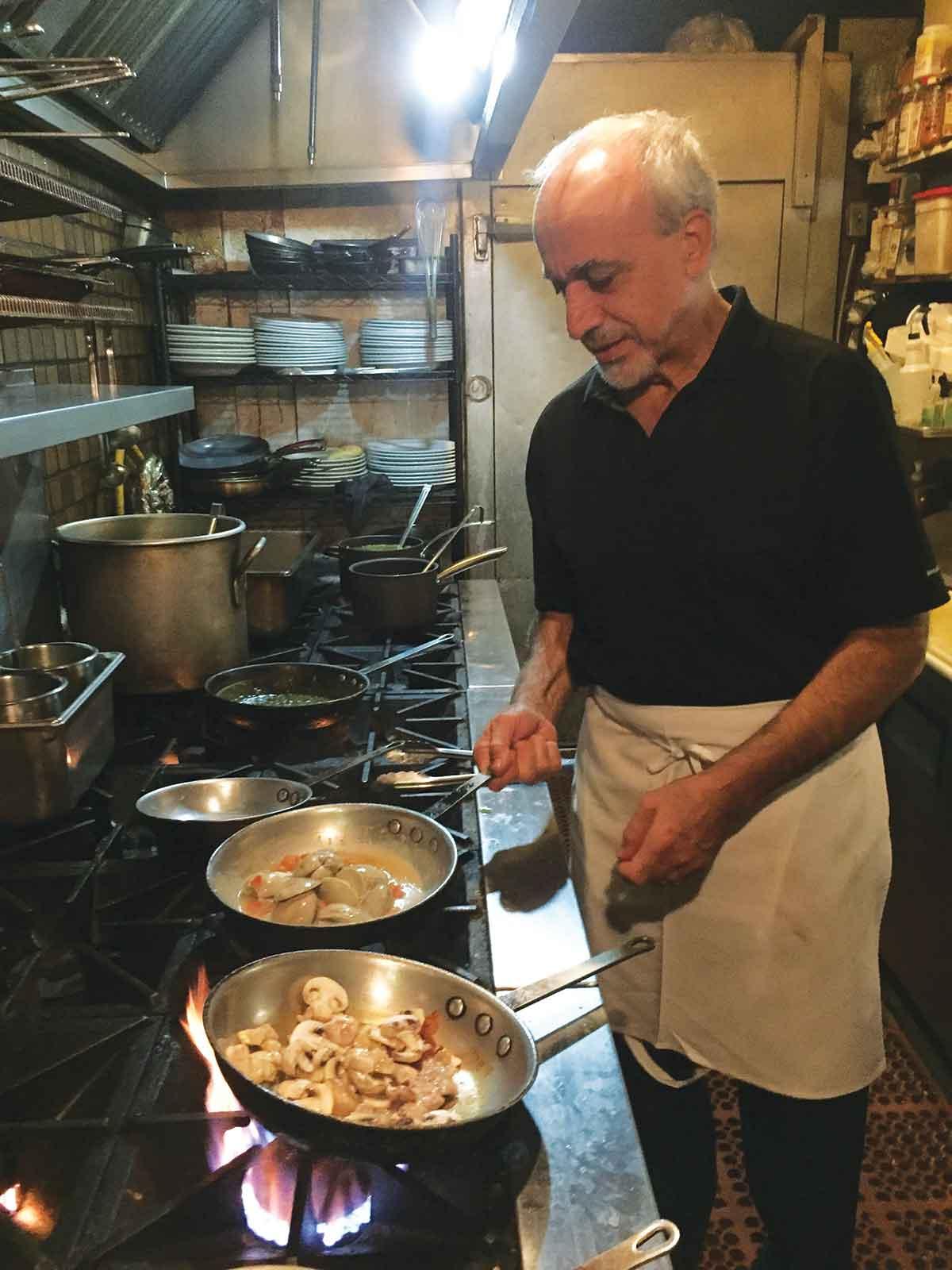 Chef Reza Azeri sautées clams for a dish called vongole. – Kristen Kumakura