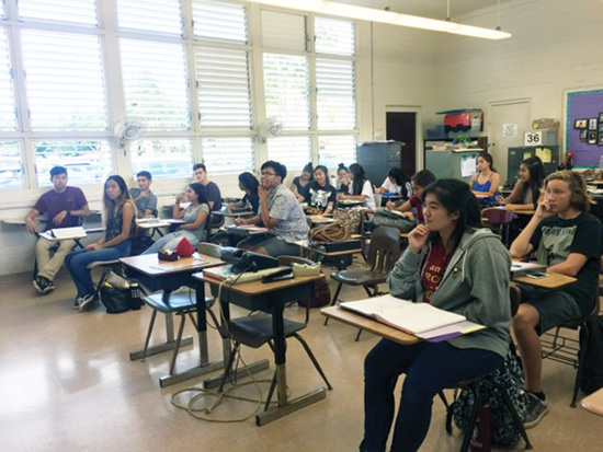 Early College students at Castle High School listen intently to an ECON 130 lecture by professor Briggs – Esther Higa